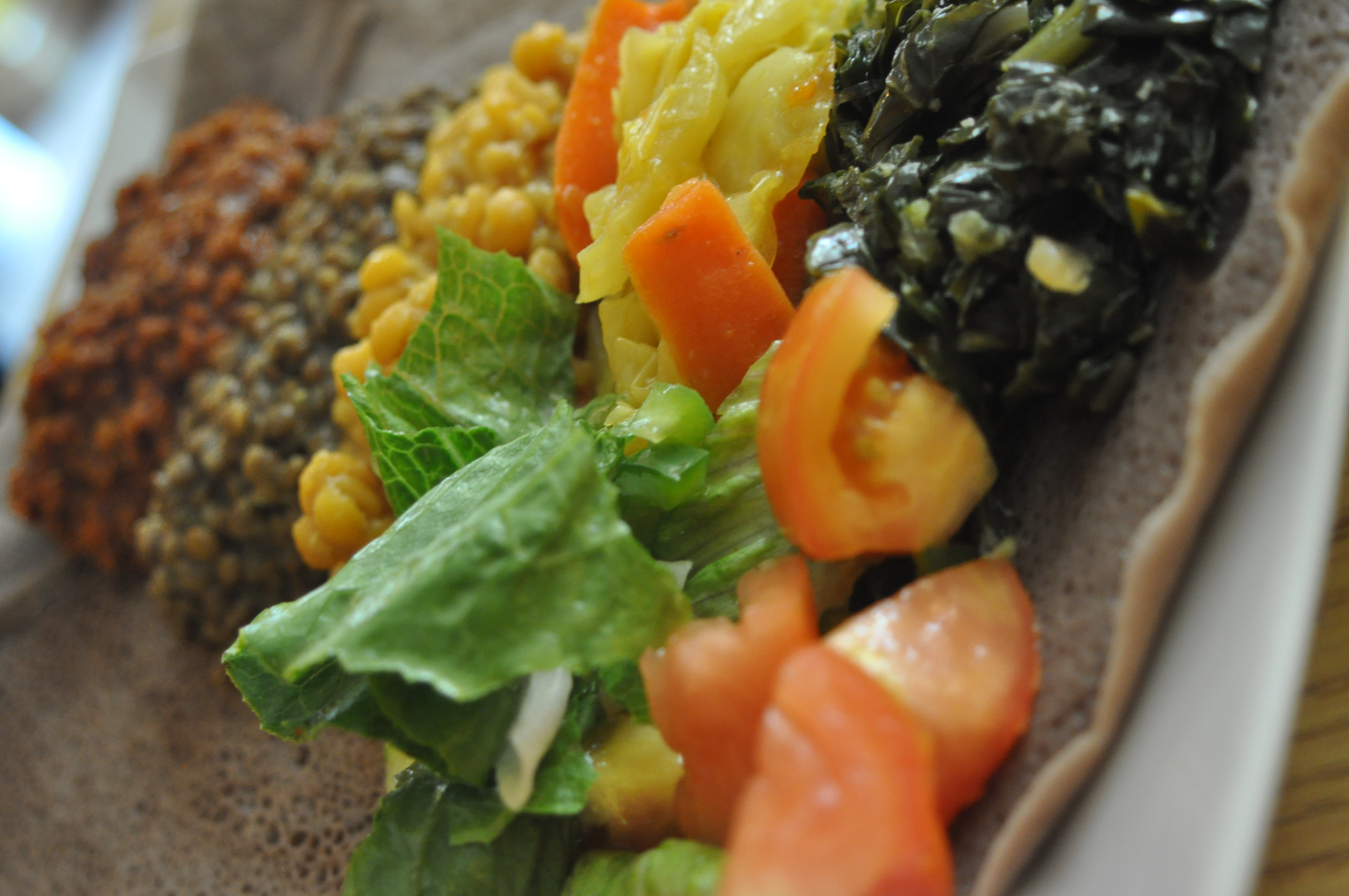 Ethiopian food is typically served on one large platter and is meant for the group to share. All food is eaten with your hands. Specifically with your right hand